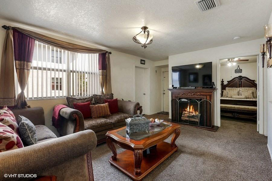 Model living room with couch and fireplace