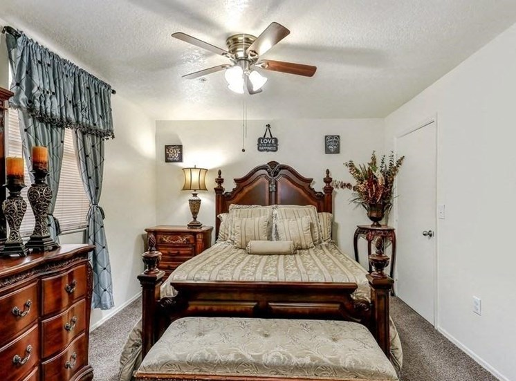 Model bedroom with large bed and dresser