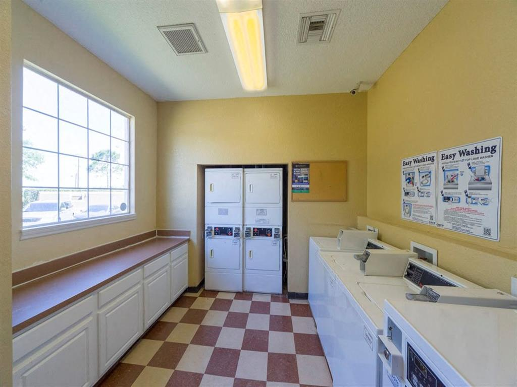 Laundry Care Center with Machines and Folding Counter