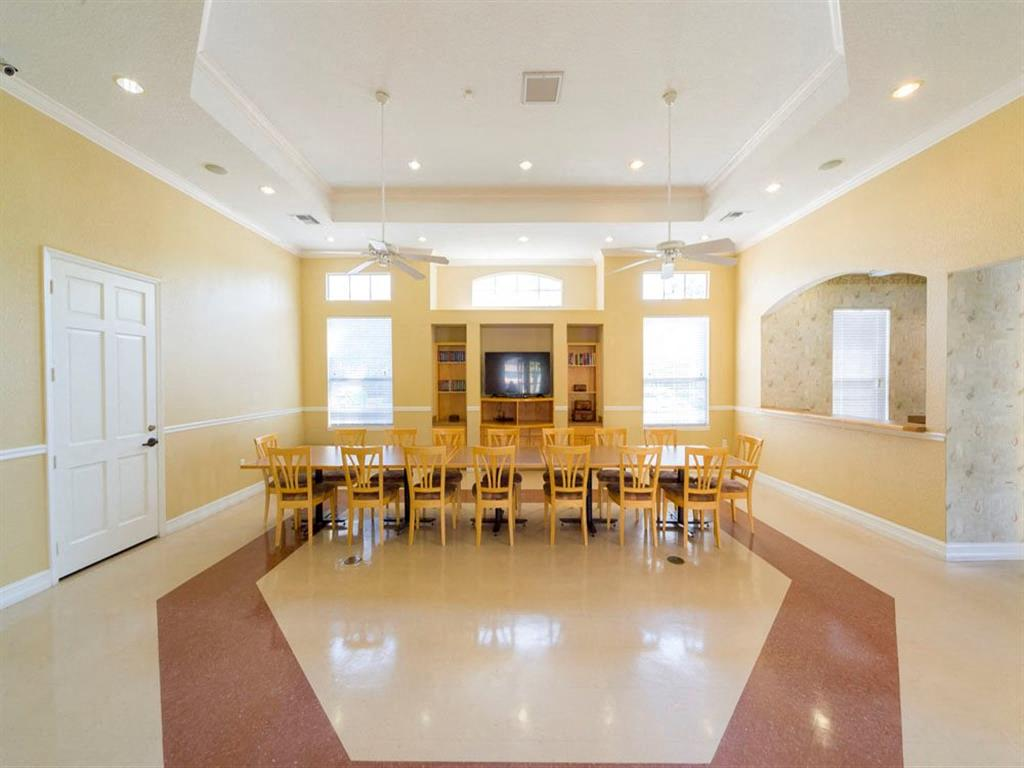 Bright Spacious Community Center with Large Table and TV