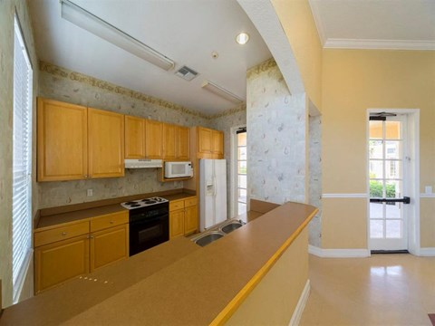 Community Center Kitchen with Light Wood Cabinets and Tan Counters