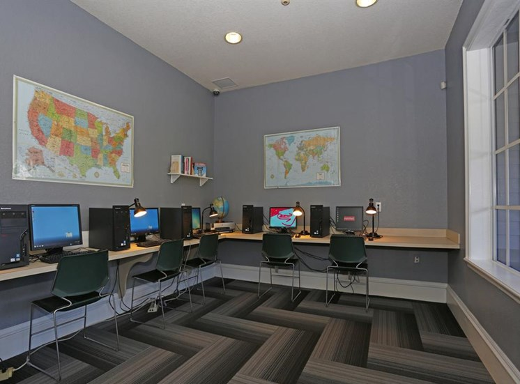Business Center with Computers and a Printer on Tan Counter with Rolling Chairs