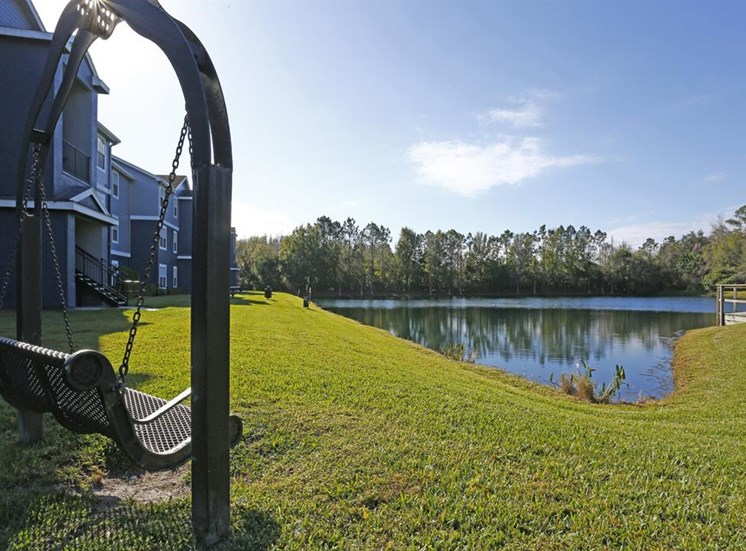 Waterfront View with Swing and Trees and Building Exteriors