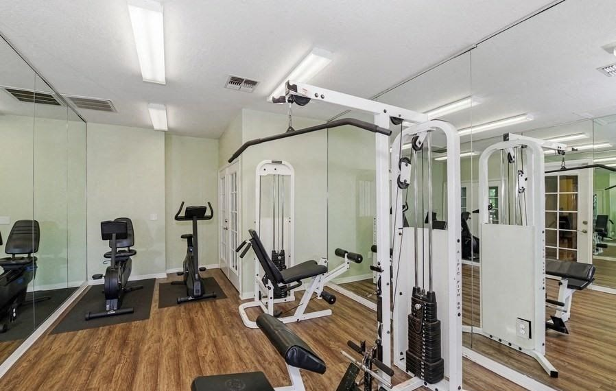 Fitness Center with Exercise Equipment  and 2 Mirror Walls