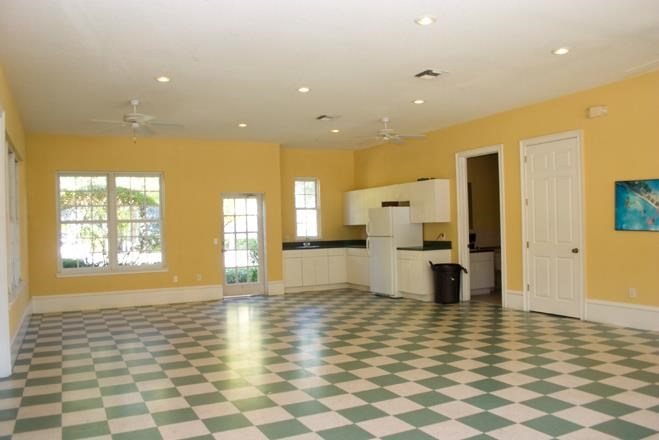 Room with Checkered Floor and Counters Cabinets and Fridge