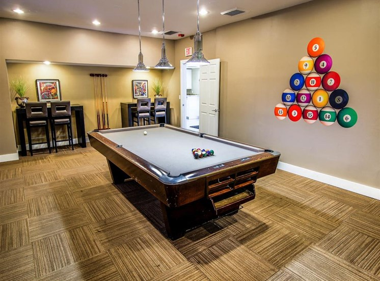 Billiards Room with Billiards Table and Bar Height Tables with Chairs