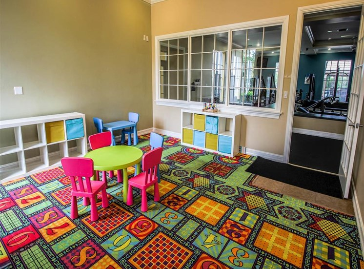 Bright Colorful Activity Room with Miniature Table and Shelves