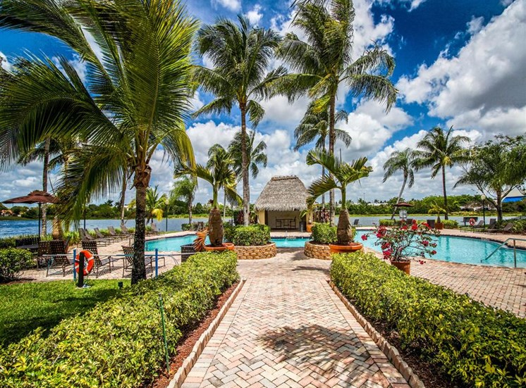 Walkway with Palm Trees to Waterfront Resort Style Swimming Pool