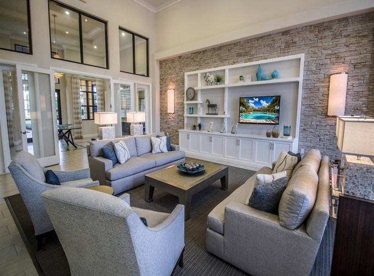 Clubhouse Seating Area Around Built in Entertainment Center with TV Mounted Above