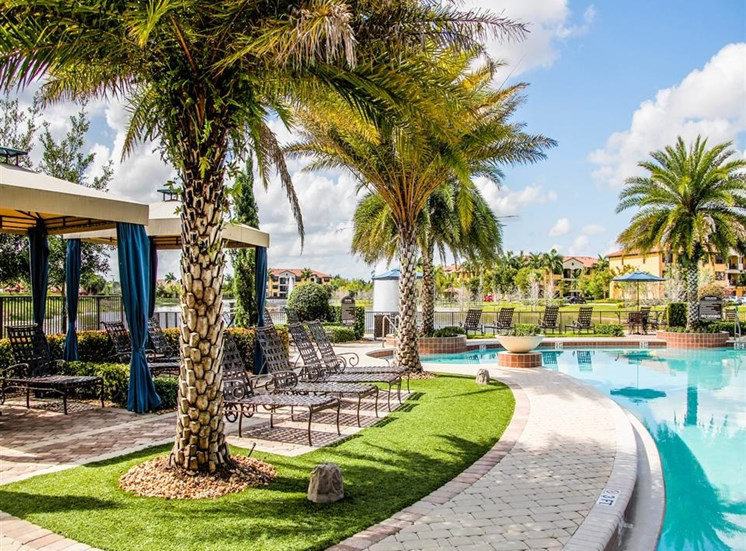 Poolside Cabanas on Sundeck Next to Palm Trees