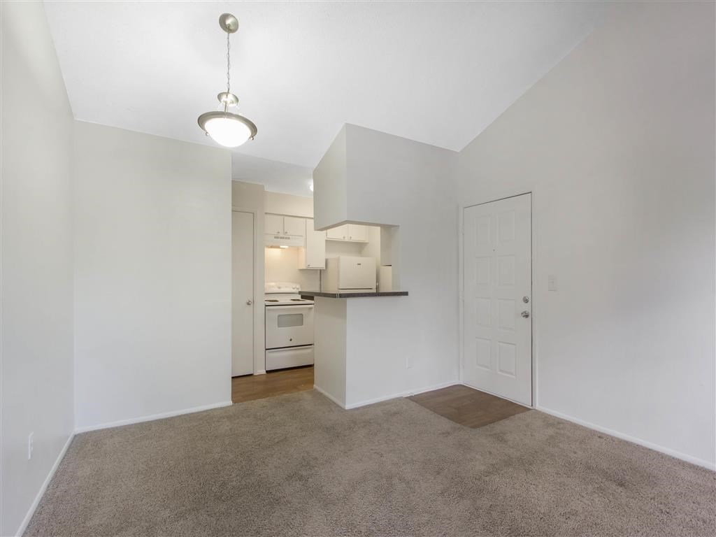 Open Layout Floor Plan with Breakfast Bar off of Kitchen with White Appliances and Kitchen
