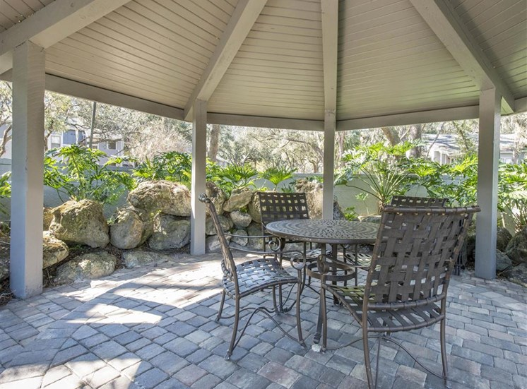 Gazebo Surrounded by Rocks with Picnic Table