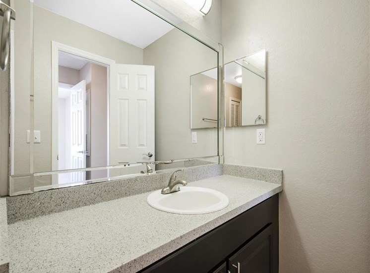 Bathroom Vanity with Brown Cabinet Under Mirrored Medicine Cabinet
