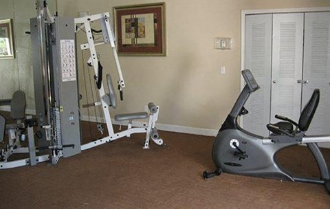 Fitness Center with Exercise Equipment and Sliding Door