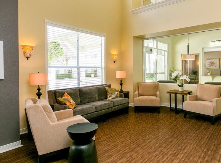 Leasing office seating area with couch and chairs