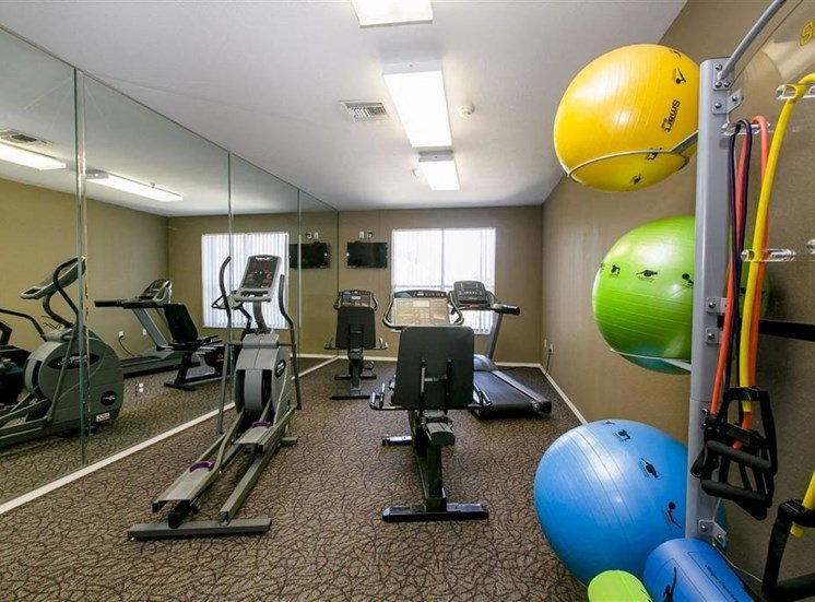 Fitness center with exercise balls and elliptical