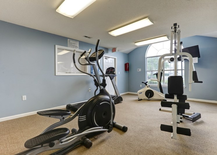 Fitness center with ellipticals and weight lifting station