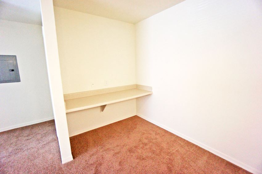 Built in desk area in carpeted dinning room