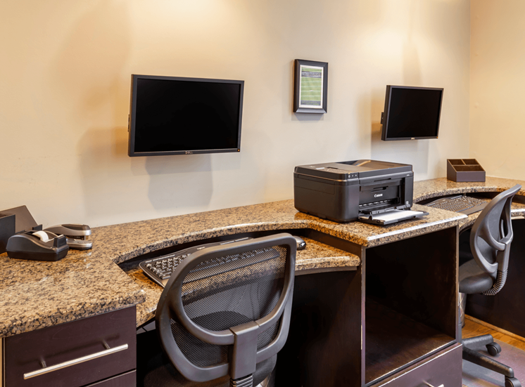 Business Center with Monitors Mounted Over Desk with Rolling Chairs