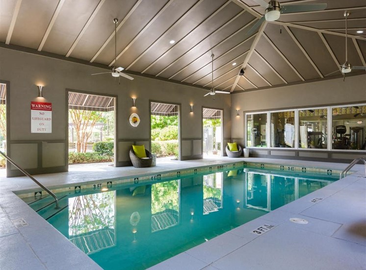 Covered Swimming Pool with Ceiling Fans and Pool Chairs