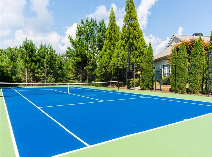 Fenced in Blue and Green Tennis Court