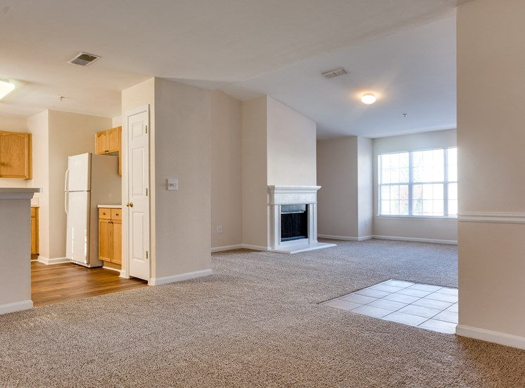 Open Floor Plan with Kitchen White Appliances and Blonde Wood Cabinets and Grey Counters