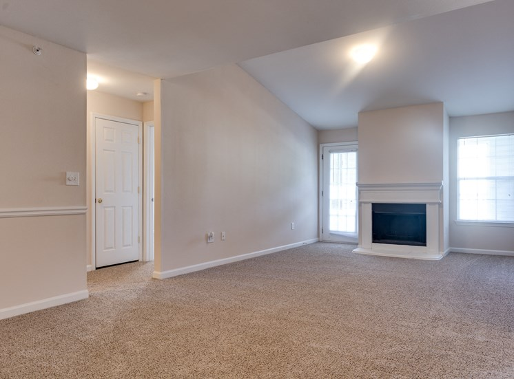 Carpeted Living Room with Fireplace