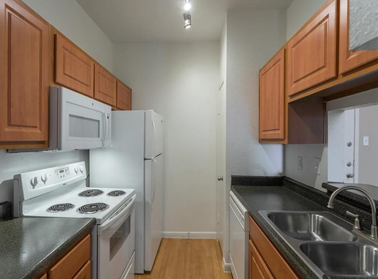 Fully Equipped Kitchen with White Appliances and Double Basin Sink