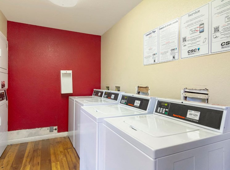 Clothes Care Center  with washer and dryers on either side of the room