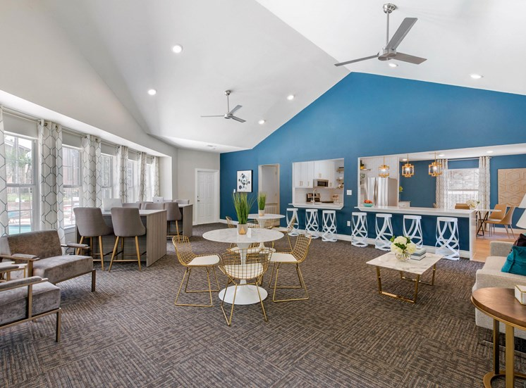 Clubhouse Lounge with Blue Accent Wall and Contemporary Furniture