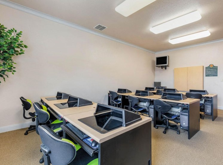 Computer lab with computers, desks, and chairs