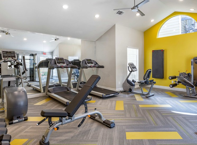 Fitness Center Strength and Conditioning Equipment and a Yellow Accent Wall