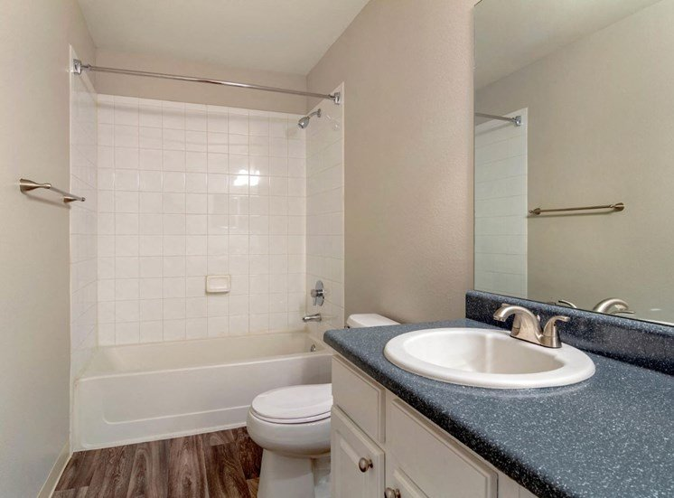 Legacy Heights Apartments | Bathroom with Garden Style Tub
