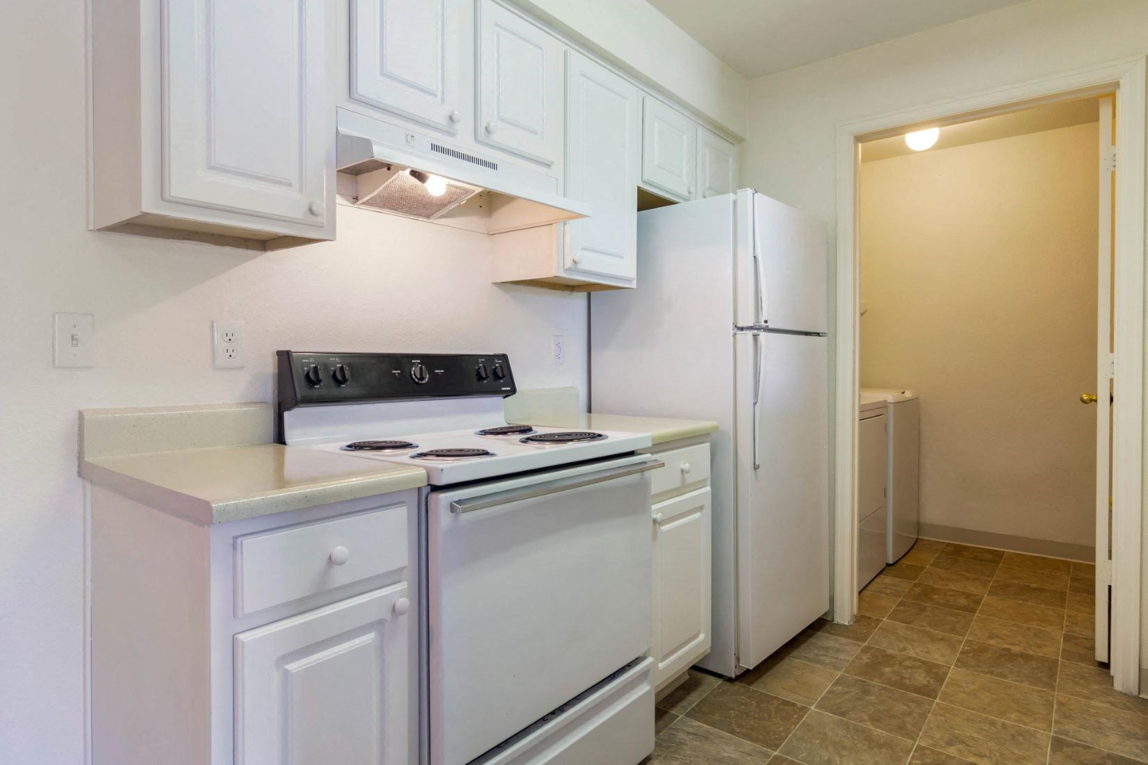 Legacy Heights Apartments | Fully Equipped Kitchen with Laundry Room