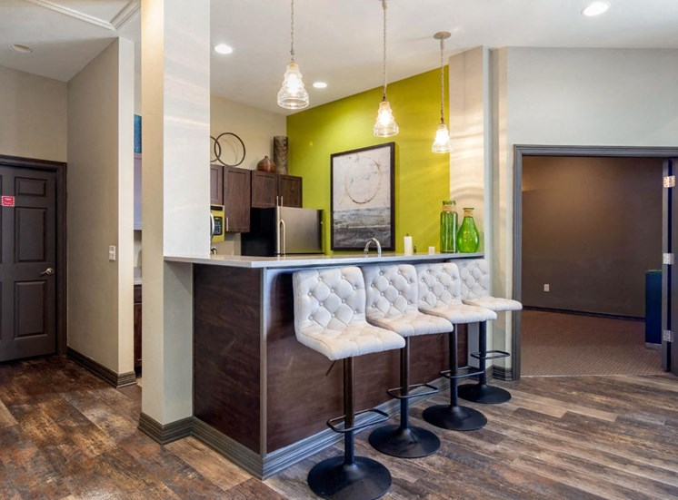 Clubhouse Kitchen Area with Breakfast Bar and Green Accent Wall