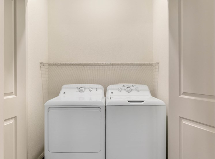 Full  Sized Washer and Dryer in Utility Closet