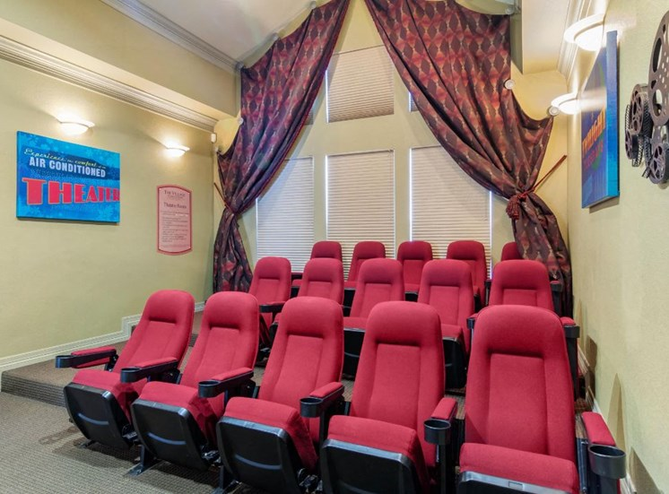 Resident Movie Theater with Theatre Style Red  Chairs in Front of Windows with Blinds and Curtains