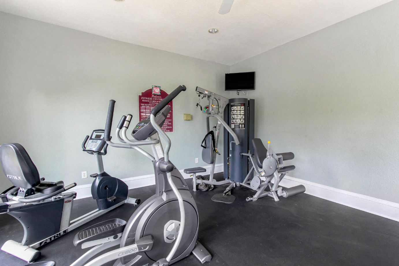 Fitness Center with Exercise Equipment and Mounted TV