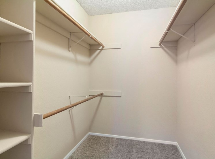 Spacious Walk In Closet with Built In Storage