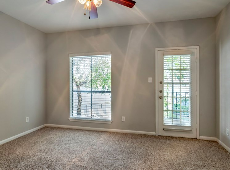 Living room with ceiling fan and carpet flooring