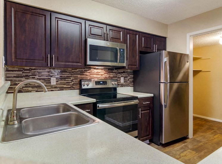 Fully Equipped Kitchen with Espresso Cabinetry