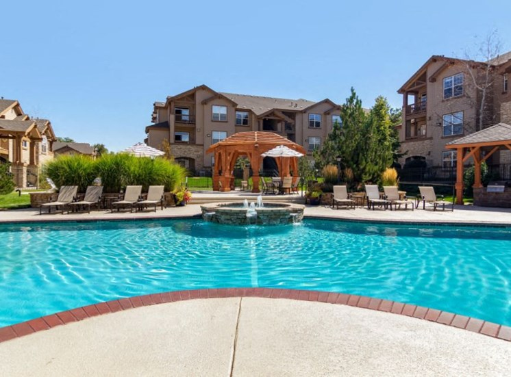 The Village at Legacy Ridge Apartments | Pool with Tanning Deck