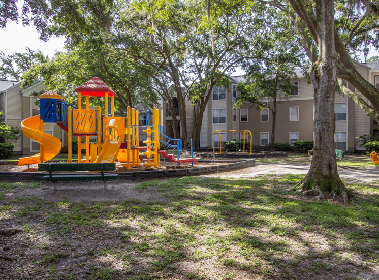 Outdoor Playground equipped with a slide, monkey bars, and latter