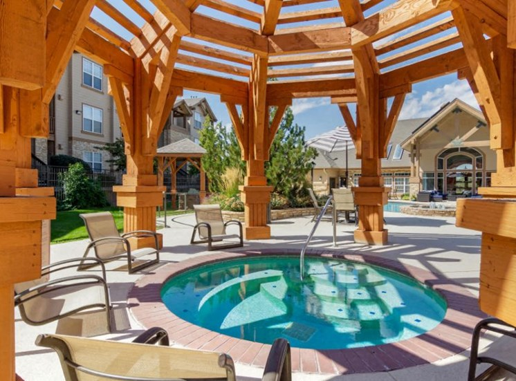 Poolside Sun Deck with Lounge Chairs and Pergola Over Hot Tub