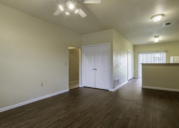 Dining room and view of living room with hardwood style flooring