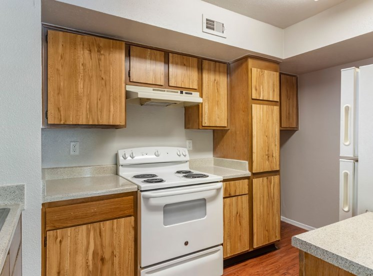 Fully equipped kitchen with dishwasher, double basin sink, and hardwood style flooring