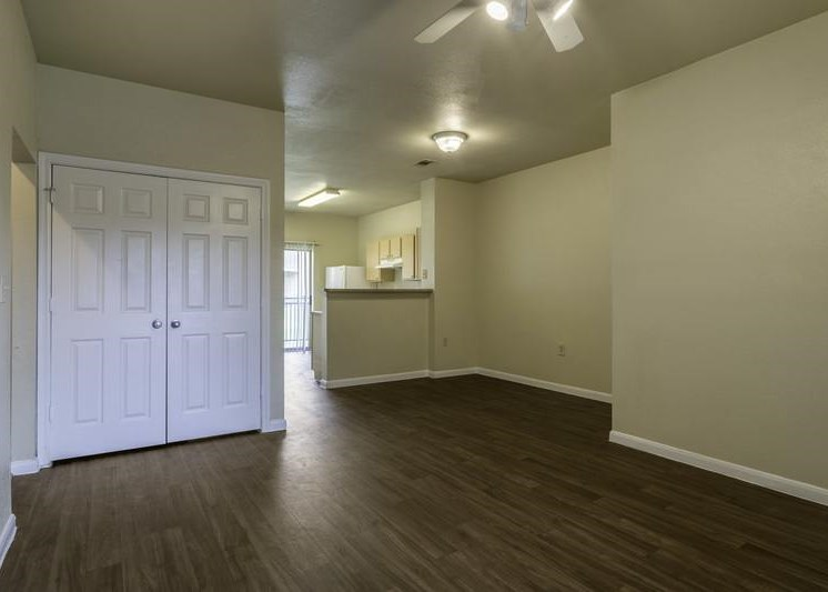 Dining room and view of living room with hardwood style floorings
