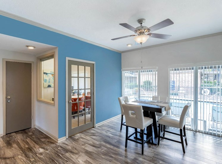 Clubhouse Interior with blue accent wall, ceiling fan, and hardwood style flooring