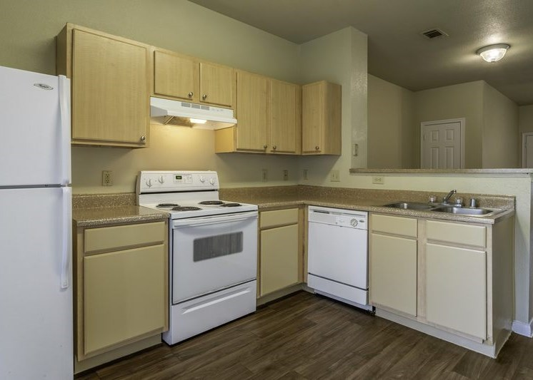 Fully equipped kitchen with hard wood style flooring
