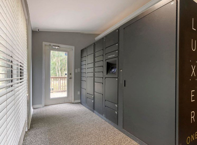 Indoor Package Cache Lockers in Carpeted Foyer